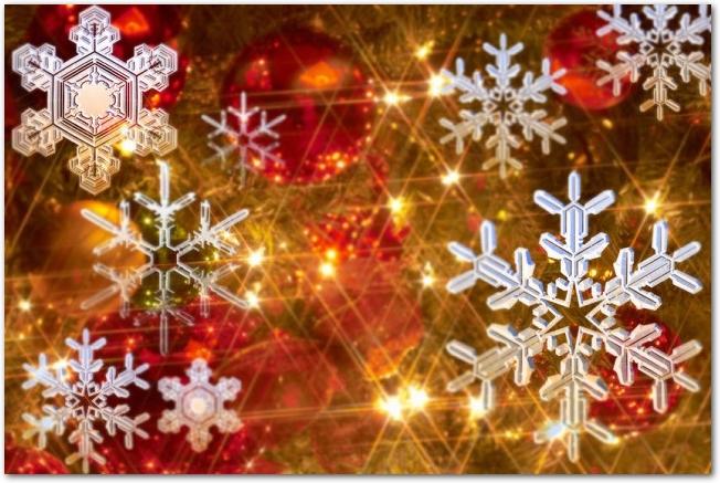 雪の結晶とクリスマスイルミネーションの耀き